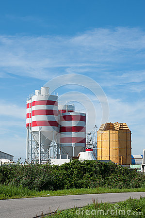 Storage tanks with red stripes