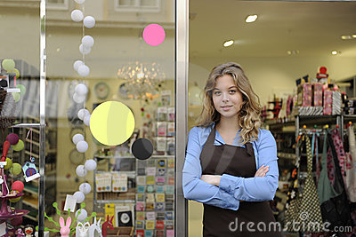 Store owner in front of gift shop