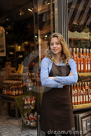 Free Store Owner In Front Of Shop Royalty Free Stock Images - 21322909