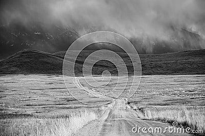 Storm Cloud Passing Through a Barren Mountain Land