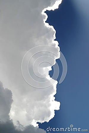 Storm Clouds in Blue Sky