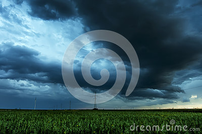 Storm clouds flying over field