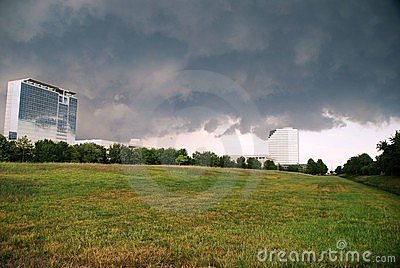Storm clouds over office buildings