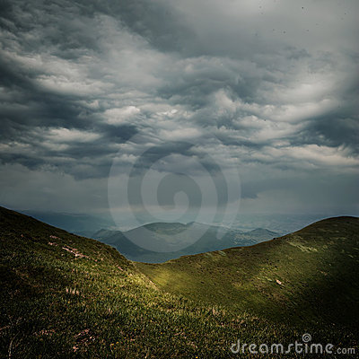 Free Storm Clouds Over The Mountains Royalty Free Stock Photos - 20358078