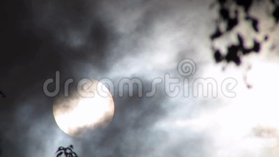 Storm clouds. Parting to reveal the sun stock video footage