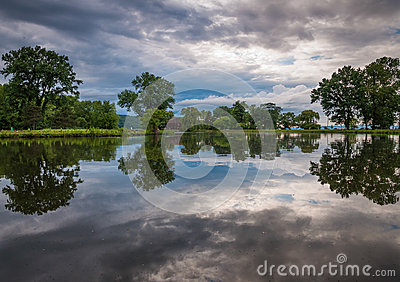 Storm clouds reflect in a pond at Stewart Park in Ithaca, NY
