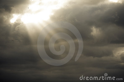 Storm clouds with sun rays