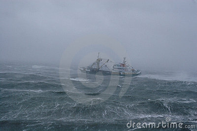 Storm,rain and a fishing boat.