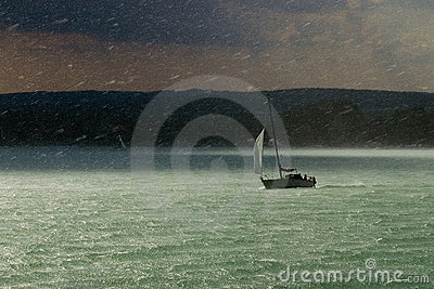 Storm, rain and sailboat