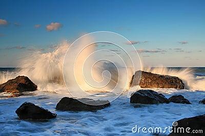Storm waves on the sunrise