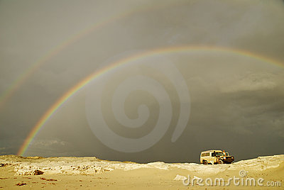 Stormy Rainbow Over Offroad Car