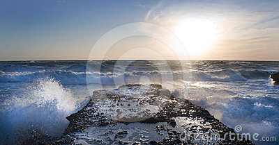 Stormy sea crashes in the rocks