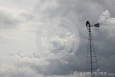 Stormy skies and windmill