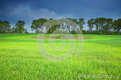 Stormy sky over a green field