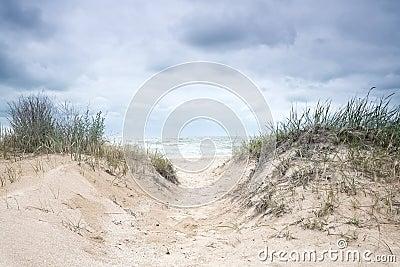 Stormy sky over the sea deserted beach