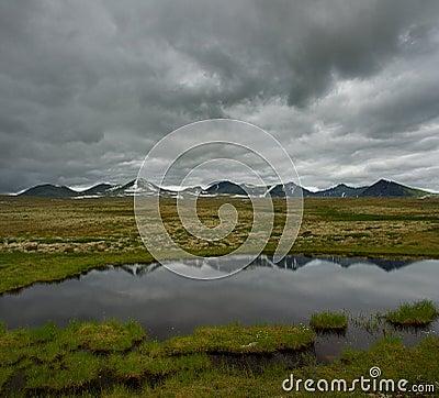 Stormy sky over valley in scandinavia