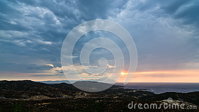 Stormy sky, sunrise at sea and landscape around holy mountain Athos