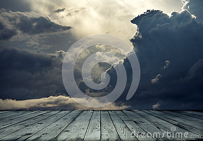 Stormy sky and wood floor