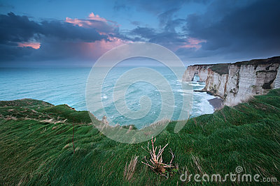 Stormy sunrise over cliffs in Atlantic ocean