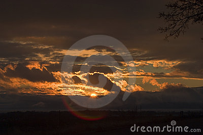 Stormy sunset over Utah Lake with lens flare