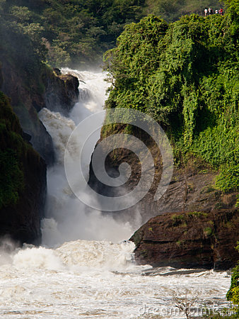 Stormy waterfall on the background of people