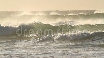 Stormy waves. Large coastal waves and water spray during a storm with strong winds stock footage