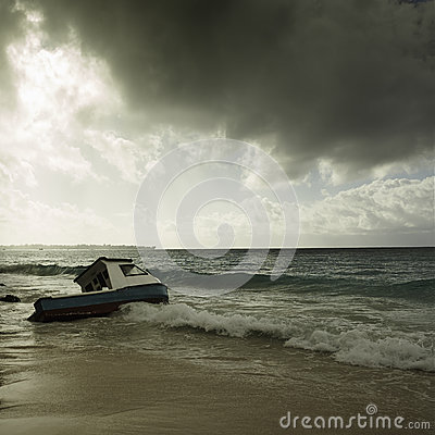 Free Stormy Weather And Fishing Boat Stranded On A Beach Royalty Free Stock Photography - 51533297