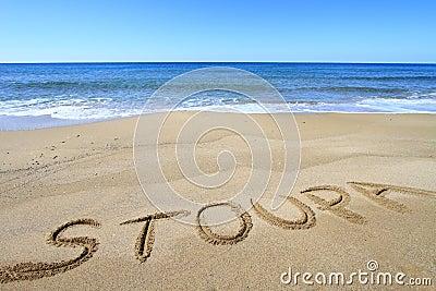 Stoupa written on the beach