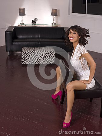 Young Woman Straddles the Chair Living Room