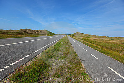 Straight, flat road landscape with a bicycle lane
