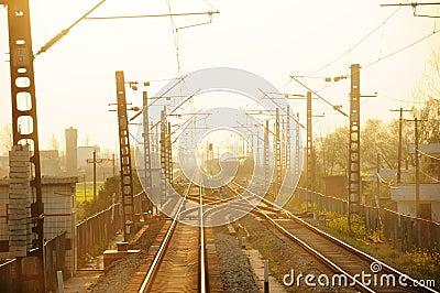 Straight railway bridge at sunset.
