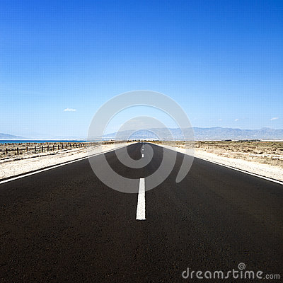 Straight road in desert. Cabo de Gata, Andalusia.
