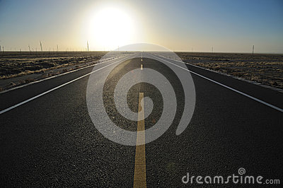 Straight  road at sunrise