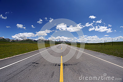 Straight road under blue sky
