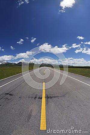 Straight road under blue sky