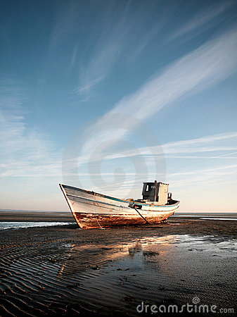 Free Stranded Boat On The Beach Royalty Free Stock Photo - 16402385