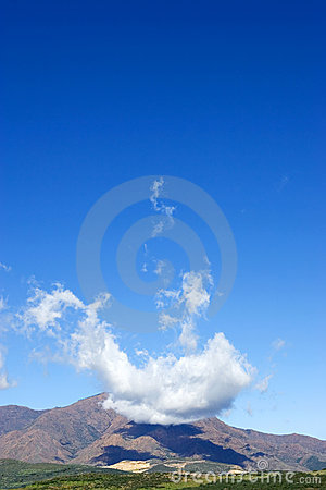Free Strange And Unique Cloud Formations Over Large Mountain Royalty Free Stock Photography - 575657