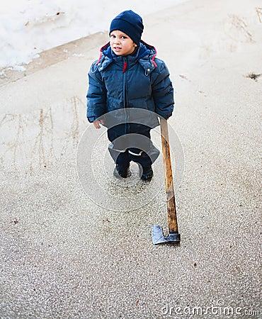 Strange child holding axe