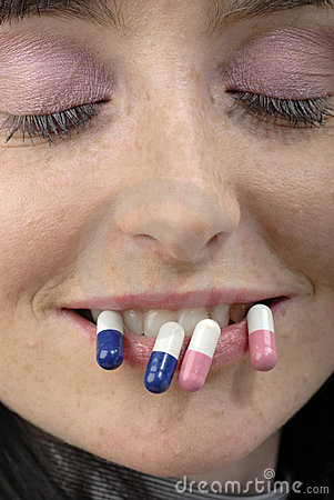 Strange face with pills