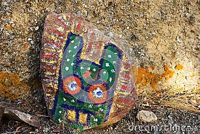 Strange face  on a stone