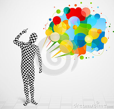 Strange guy in morphsuit looking at colorful speech bubbles Stock Photo