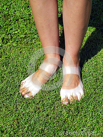 Strangely tanned legs on the lawn