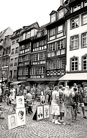 Strasbourg downtown with people and painters Editorial Stock Image