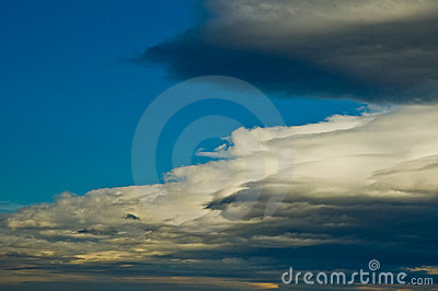 Stratus cloud formation rolling accross blue sky