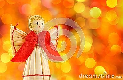 Straw angel on the background lights defocus