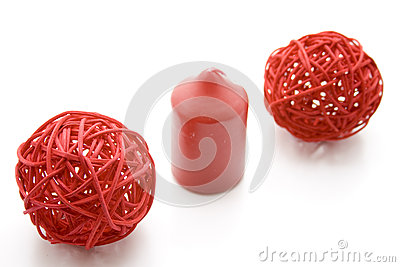 Straw balls and red candle