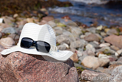 Straw hat on big rock