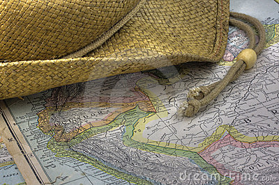 Straw hat over vintage map of South America