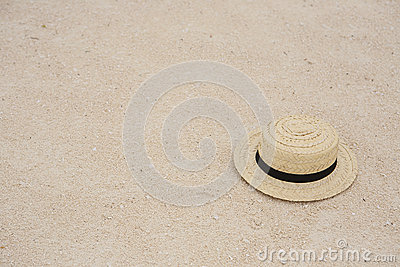 Straw sun hat in the sand
