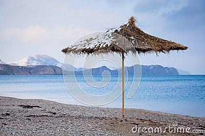 Straw umbrella on beach